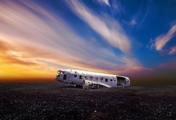 sunset view of a  plane wreck near Vik in south Iceland