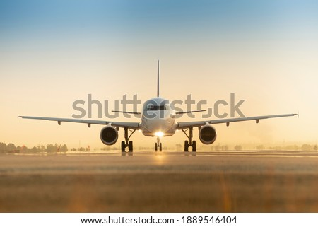 Sunset view of airplane on airport runway under dramatic sky Photo stock ©