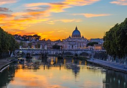 Sunset view of Basilica St Peter, bridge Sant Angelo and river Tiber in Rome. Italy. Architecture and landmark of Rome. Postcard of Rome