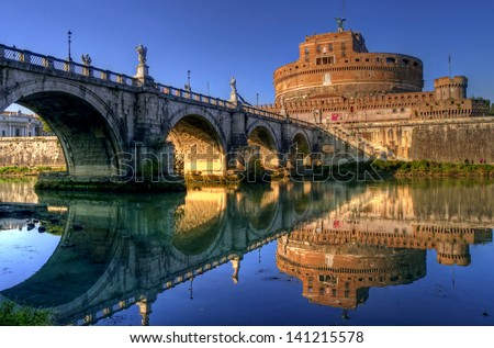 Sunset view of Castel Sant'Angelo and Ponte Sant'Angelo, Rome, Lazio, Italy - stock photo