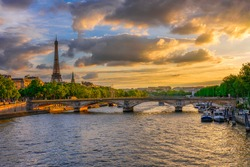 Sunset view of Eiffel tower and Seine river in Paris, France. Eiffel Tower is one of the most iconic landmarks of Paris. Cityscape of Paris