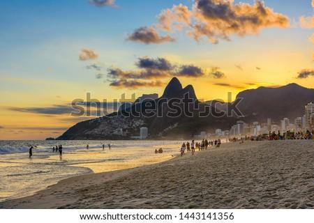 Sunset view of Ipanema beach, Leblon beach and the Mountain Dois Irmao in Rio de Janeiro, Brazil. Ipanema beach is the most famous beach of Rio de Janeiro, Brazil. Sunset cityscape of Rio de Janeiro