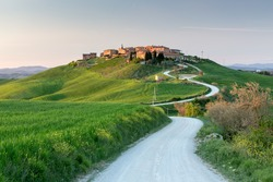 Sunset view of Mucigliani village, Tuscany, Italy
