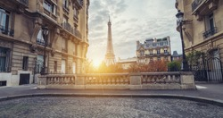 Sunset view of the Eiffel Tower from the Avenue de Camoens of in paris, france