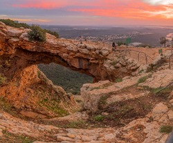 Sunset view of the Keshet Cave, a limestone archway spanning the remains of a shallow cave, in Adamit Park, Western Galilee, Northern Israel