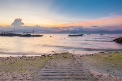 Sunset view of the Moalboal beach famous diving and snorkeling spot in Cebu with Negros island on the background, Philippines