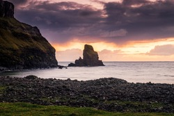 Sunset view of the rocky Talisker Beach