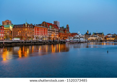 Sunset view of waterfront alongside a channel in Malmo, Sweden #1520373485