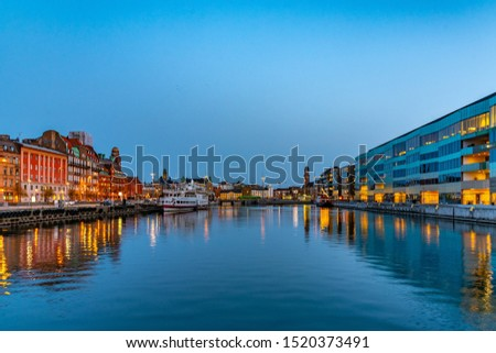 Sunset view of waterfront alongside a channel in Malmo, Sweden #1520373491