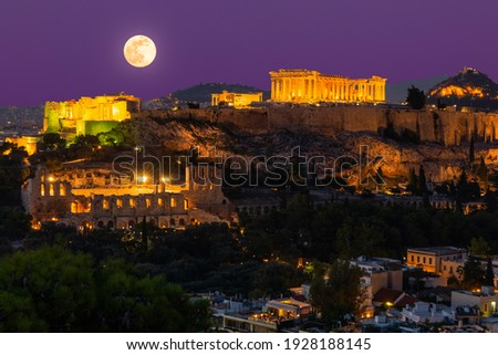 Sunset view on Acropolis in Athens, Greece at with full moon. Travel in Greece