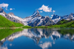 Sunset  view on Bernese range above Bachalpsee lake. Popular tourist attraction. Location place Swiss alps, Grindelwald valley, Europe.