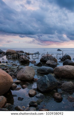 Sunset view over Baltic sea with stones