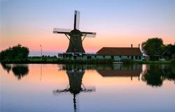 Sunset windmill farm river reflection. Windmill sunset river. Sunset windmill river