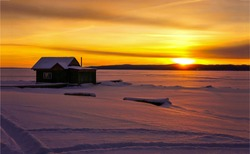 Sunset winter snow hut view. Sunset winter snow hut on rural landscape