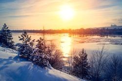 Sunset winter snow nature river horizon landscape. Winter snow forest river sunset view. Sunset winter river snow.