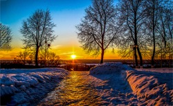Sunset winter snow park alley view. Winter sunset snow park. Winter snow sunset scene. Winter sunset snow scene