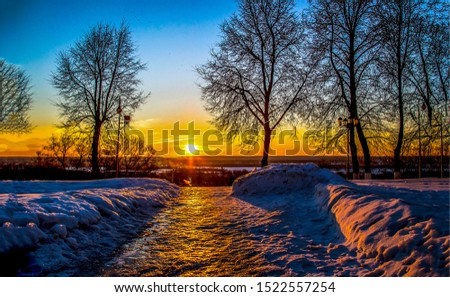 Sunset winter snow park alley view. Winter sunset snow park. Winter snow sunset scene. Winter sunset snow scene