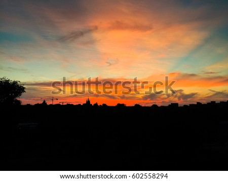 Sunset with city silhouette #602558294