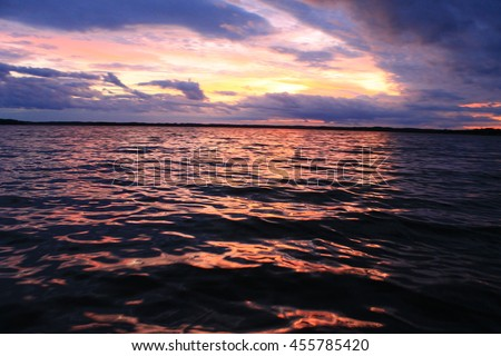 Sunset with clouds at the lake #455785420