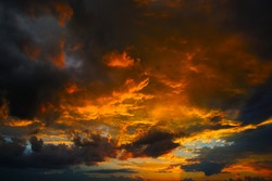Sunset with clouds, in orange and purple shades