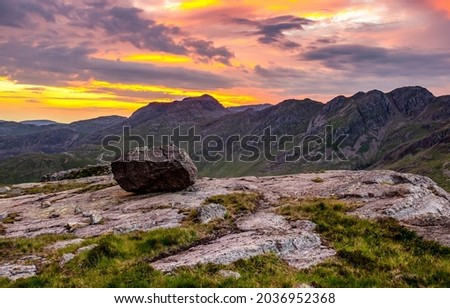 Sunset with clouds in the mountains. Mountain sunset sky. Sunset in mountains. Mountain sunset landscape