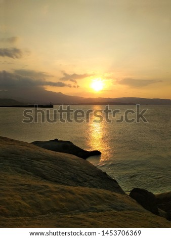 Sunset with clouds over sea, calm and lonely feeling. Serenity and calmness on a coastline