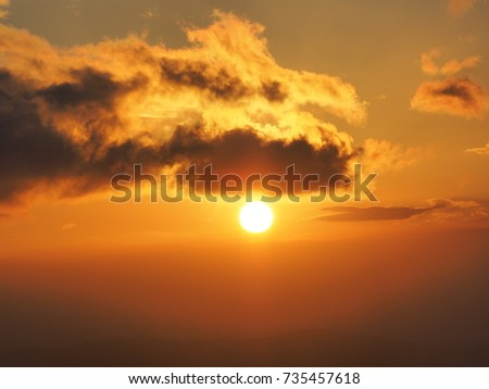 sunset with colored cloud - Shutterstock ID 735457618