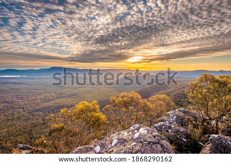 Sunset with dramatic clouds at Grampians with rocks and trees Stock photo ©