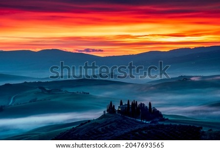 Sunset with fog over the mountain hills. Mountain sunset landscape. Sunset in mountains. Mountain sunset fog