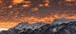 Sunset with mountains covered in snow in the French Alps.