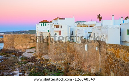 Sunset with pink colors in Asilah and atlantic ocean in Morocco, Africa