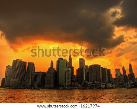 sunset with sky like fire over lower manhattan