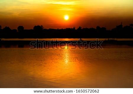 Sunset with twilight light at Ping river, Kamphaeng Phet province.