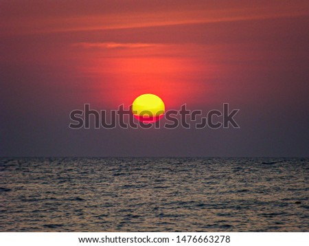 Sunset, Wonderful dark red sky with the sun above the sea level, Amazing colourful skyline in evening during the sun going down, Beautiful nature background.