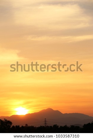 Sunset Yellow gold sky evening In tropical countries summer #1033587310