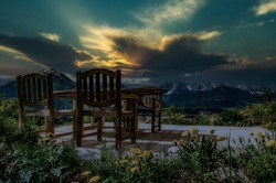sunsets over mountains, chairs, forest
