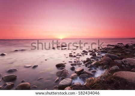 Sunsetting over the baltic sea, beautiful summer scene