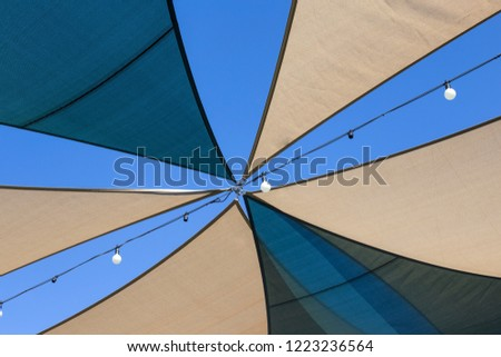 Sunshade awnings tent with sky. sunblind