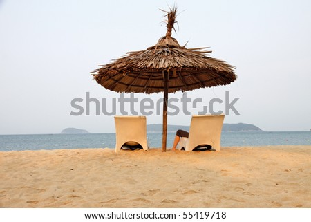 Sunshade on a lonely beach - stock photo