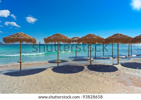Sunshades at the beach of Elafonisi/Crete/Greece - stock photo