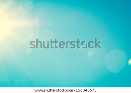 Sunshine and blue sky with flares in summer