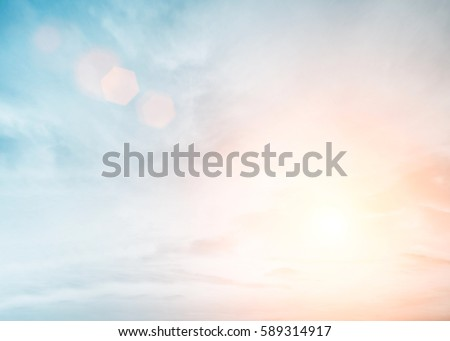 Photo of  Sunshine clouds sky during morning background. Blue,white pastel heaven,soft focus lens flare sunlight. Abstract blurred cyan gradient of peaceful nature. Open view out windows beautiful summer spring