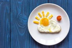 sunshine fried eggs breakfast for kid on blue background