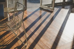 Sunshine in the morning through the windown with line of shadows at coffee shop.