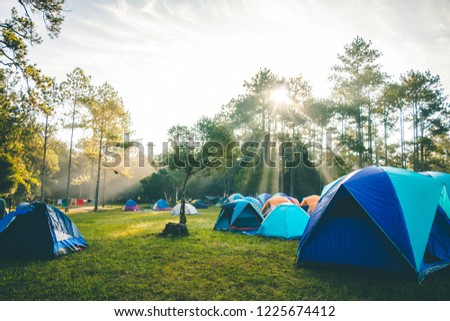 Sunshine in the morning with a camping in the forest. #1225674412