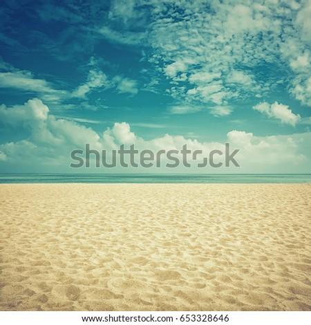 sunshine on empty sunny beach ...