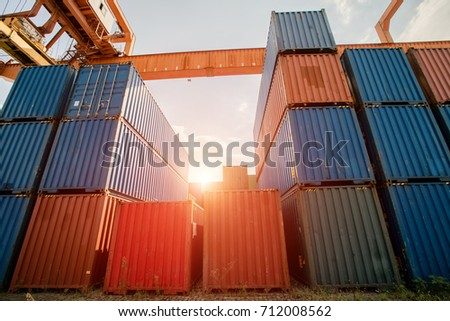 sunshine on the stack of cargo container and crane in port
