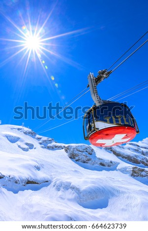sunshine over cable car to...