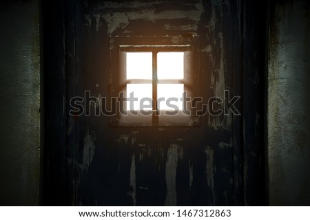 Sunshine Shining In Prison Cell Window. Prison cell with light shining through a barred window. Jail interior, Built Structure, Concrete, Door, Entrance,  the freedom, dark background, Imprison #1467312863