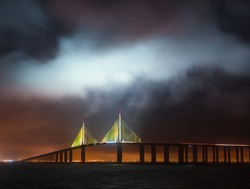 Sunshine Skyway Bridge in Tampa Bay Saint Petersburg Florida at night in a stormy sky